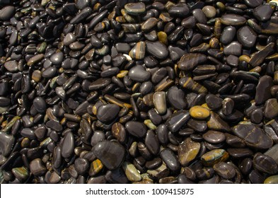 The beautiful black stone from nature at koh Hin-ngam (hin-ngam islans) in Stul, south of Thailand - Shutterstock ID 1009415875