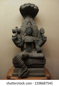 a beautiful black stone sculpture of lord goddess Parvati with snakes over the head and damru on the hand, an additional Avatar of lord Shiva.