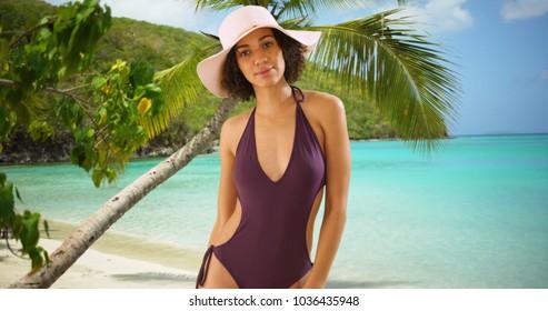 Beautiful black tourist standing on caribbean beach