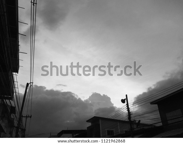 Beautiful black and white background of cloud and sky with electricity and building environment in summer sunset silhouette view