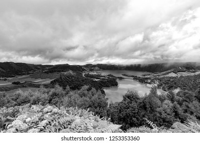 Beautiful black and white view of the massive Sete Cidades crater and village in the Azores.