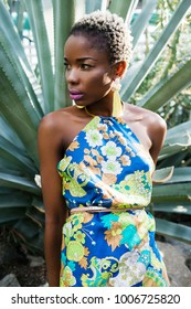 Beautiful black woman with glossy makeup. Stylish young african american teenage girl posing in  clothes in african-american fashion style.