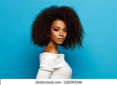 Beautiful black woman isolated on blue background