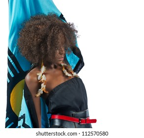 A beautiful black woman leans back as she raises her cape up over her head.
