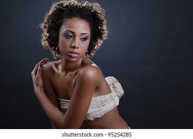 Beautiful black woman posing in a studio .Erotic art photo