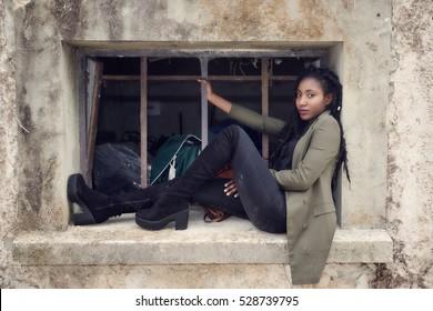 Beautiful black woman posing - window