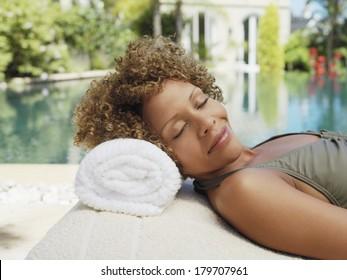 Beautiful black woman relaxing at spa