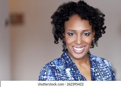 Beautiful black woman smiling at the camera