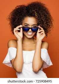 Beautiful black woman smiling and wear sunglasses