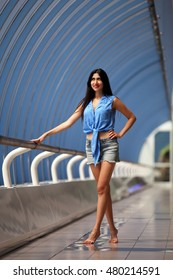 Beautiful black-haired woman wearing hotpants