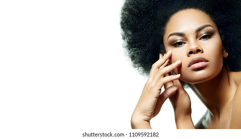 "Beautiful black-skinned girl on a white background with smooth skin, bright make-up and a lush hair style in the style of ""Afro""."