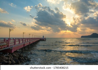Beautiful blazing sunrises landscape with cloud and sun rays at Ao Prachuap bay with Saranwithi bridge stretching in to the sea Prachuap khiri khan province, Thailand. Public domain