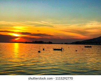 Beautiful blazing sunset landscape at black sea and orange sky above it with awesome sun golden reflection on calm waves as a background. Amazing summer sunset view on the beach. Russian nature, Sochi