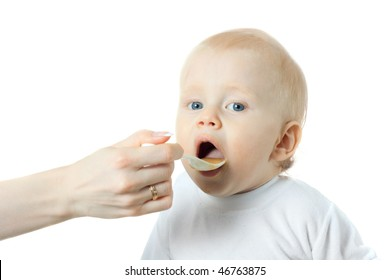 beautiful blond baby eating - isolated on white background