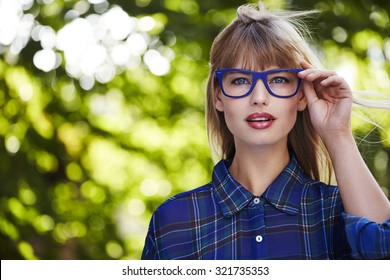 Beautiful blond in blue spectacles, portrait