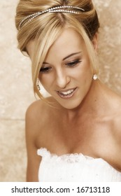 Beautiful Blond bride wearing diamond jewelery on her wedding day