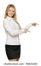 Beautiful blond business woman pointing at copy space over white background