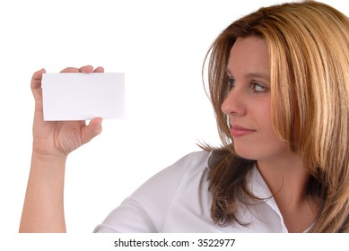 Beautiful Blond Businesswoman Holding A Blank White Business Card, Ready For Your Message, Isolated Over White