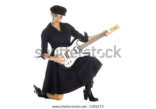 Beautiful blond dressed in black playing electric guitar