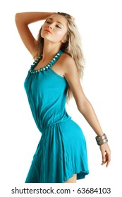 beautiful blond fashion model in blue dress and coral lips on white background.