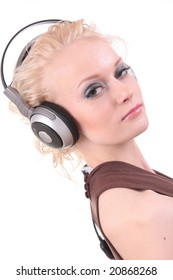 Beautiful blond fashion model posing in studio with headset