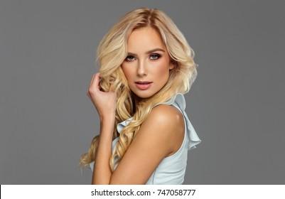 Beautiful blond female model posing