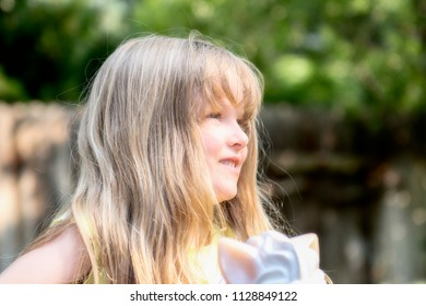 Beautiful Blond Five Year Old Playing Outside Laughing & Smiing