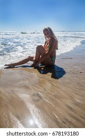 beautiful blond girl at the beach