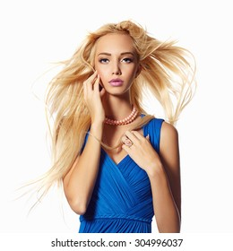 cfae5c67f93 beautiful blond girl in blue dress. beauty woman with flying healthy hair