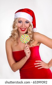 beautiful blond girl in christmas costume in studio