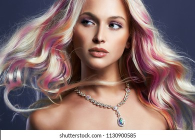 Beautiful Blond Girl With colorful Hair. Rainbow Hair Style Woman in Jewelry. Make-up