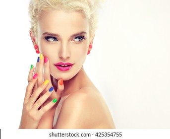 beautiful blond girl with colorful manicure nails . Cosmetics,makeup and beauty