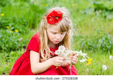 beautiful blond girl with dandelion
