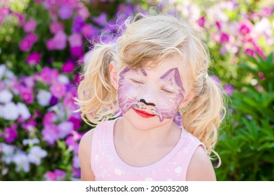 beautiful blond girl with face painting