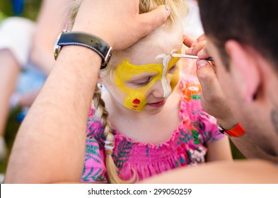 beautiful blond girl with face-painting