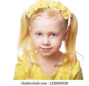 beautiful blond girl in flower crown 4 years old