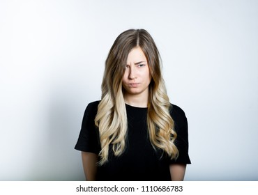 beautiful blond girl funny angry, isolated studio photo on background
