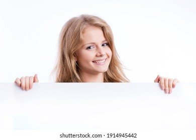 beautiful blond girl holding an empty white board and smiling