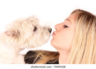 Beautiful blond girl kissing the dog