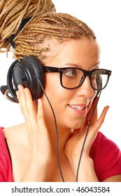 Beautiful blond girl many plaits hairstyle made by hairdresser listening to the music