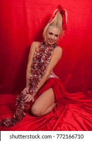 beautiful blond girl on red satin