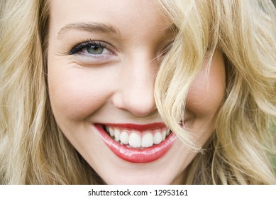beautiful blond girl smiling