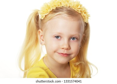 beautiful blond girl in yellow flower crown 4 years old
