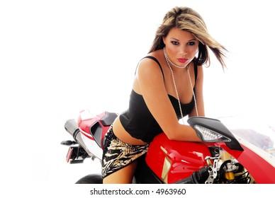 Beautiful blond glamor model on motorcycle isolated on white background
