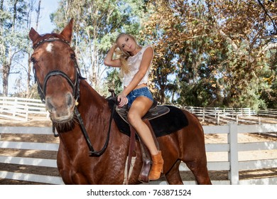 beautiful blond with her horse
