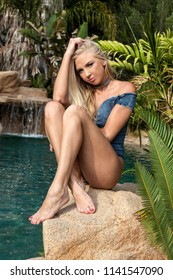 beautiful blond at her swimming pool