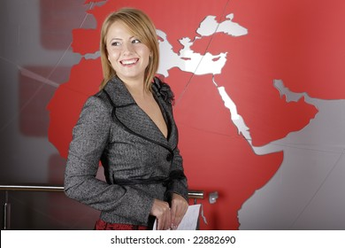 Beautiful blond journalist smiling in television studio