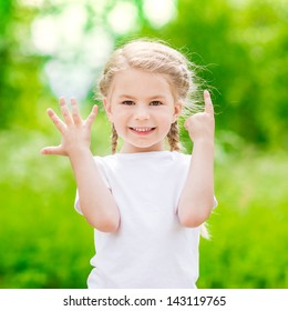 Beautiful blond little girl showing six fingers (her age) and smiling