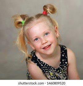 beautiful blond little girl smiling at camera studio shot