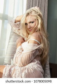 beautiful blond lounging in a chair